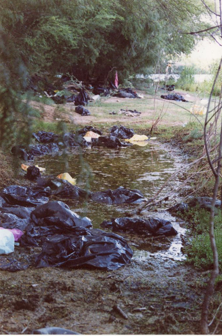 Garbage bags left by undocumented workers at landing site.