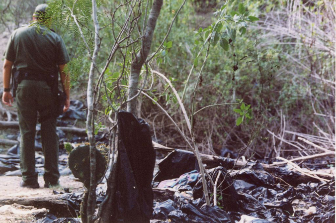 Garbage bags and trash left at landing site on Rio Grande River.