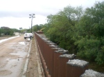 Shortened bollards atop fence, Hidalgo County, July 2011