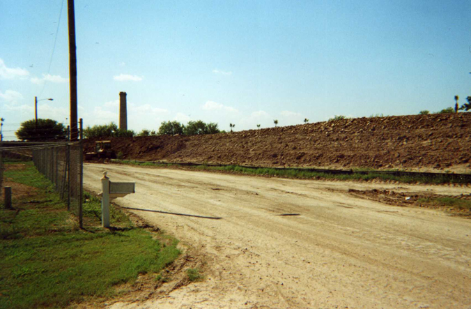 Levee raised for wall construction at Chimney Park.